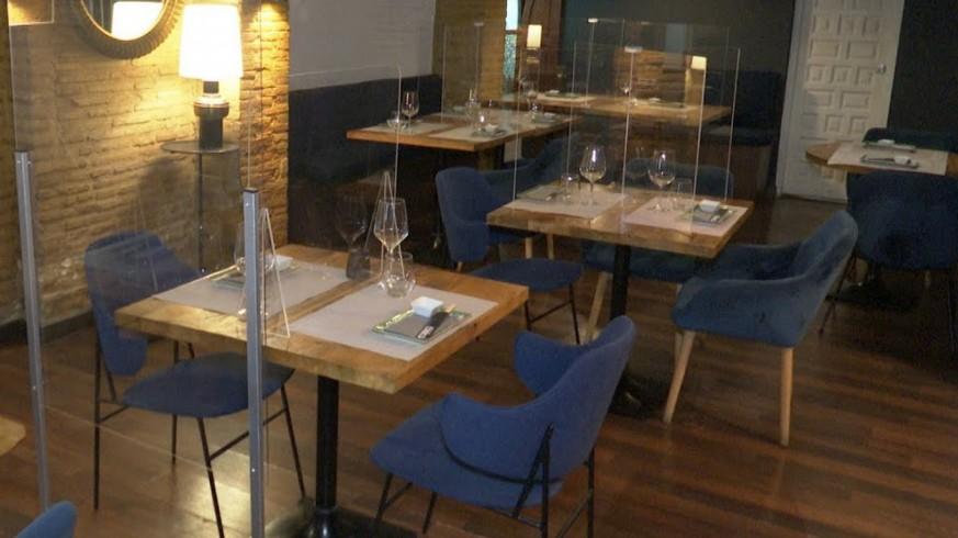 Mamparas protectoras entre las mesas de un restaurante. Europa Press