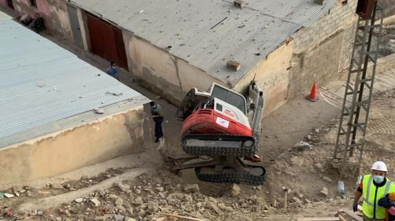 Excavadora accidentada.
