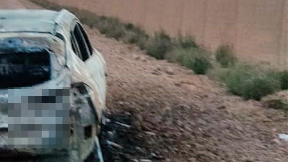 Vehículo calcinado en cuyo interior se encontraba el cadáver. GUARDIA CIVIL
